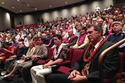 Hawaii lawmakers and invited guests gathered in a theater at the Hawaii Convention Center Wednesday, where Gov. Neil Abercrombie signed a bill legalizing same-sex marriage into law.