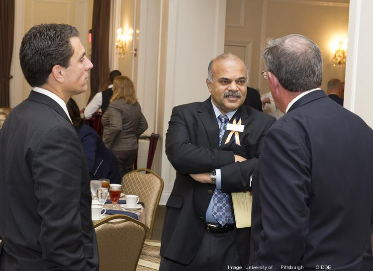 Krish Prabhu, center, CEO of AT&T Labs, speaks with Gerald Holder, U.S. Steel Dean of Engineering at the University of Pittsburgh's Swanson School of Engineering. Prabhu was one of 14 alumni honored as 2013 Legacy Laureates at a September event.