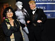 Business Journal columnist Patti Payne (left) and cartoonist David Horsey ham it up at the Washington News Council's Gridiron West gala Nov. 8 in downtown Seattle.