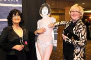 Patti Payne (left), columnist for the Puget Sound Business Journal, and a friend, Suzanna Darcy-Hennemann, pose with a modified Marilyn Monroe cutout at the Washington News Council gala in Seattle.