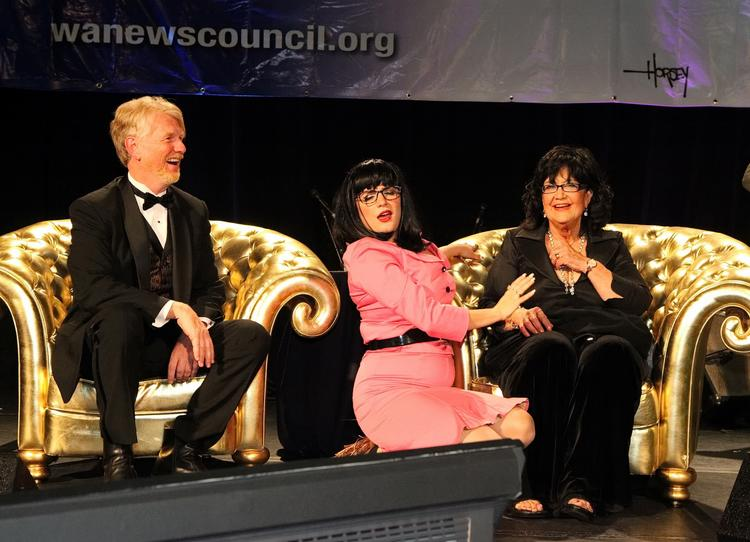 Dressed as a Patti Payne knockoff, actress and singer Caela Bailey (center) serenades honorees David Horsey (left) and Payne (right) at the Washington News Council gala in Seattle.