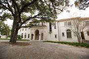 The north side of the Perry Mansion is accessed by a circular drive that is dominated by an old oak tree.