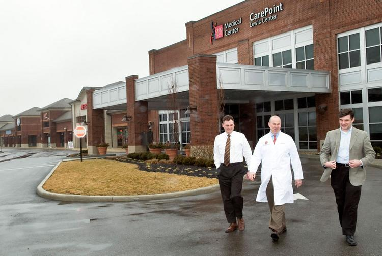Dr. Clay Marsh, executive director of the Center for Personalized Health Care at Ohio State University, is flanked by Chad Pinnell, left, and Paul Heiserman of Equity at OSU's CarePoint office in Lewis Center. Wexner Medical Center decided to put its new CarePoint in a retail plaza to accommodate patients' busy lives.