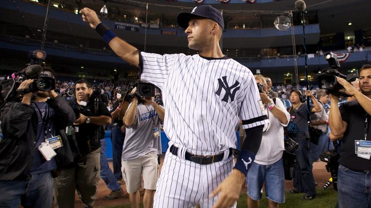 Derek Jeter waves to the crowd after the final home game at old Yankee Stadium.