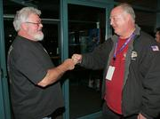 """Wilson """"Fergie"""" Ferguson (left), president of Local A of the IAM District 751 fist-bumps a fellow Machinist after the 67 percent vote against the contract extension."""
