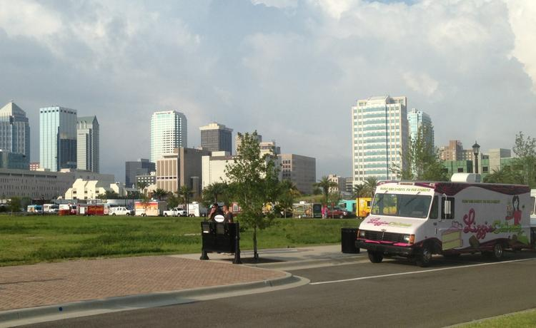 Food trucks line up for a parade in August in downtown Tampa on their way to the Florida State Fairgrounds.
