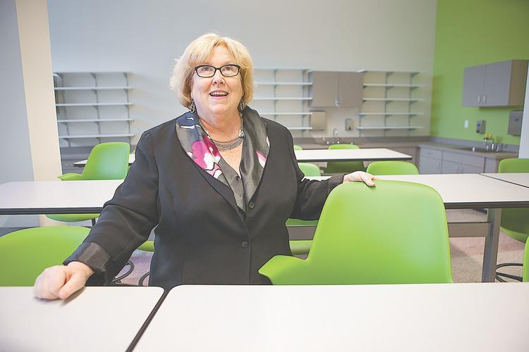 Amber Dixon, executive director of the Buffalo Center for Arts and Technology, in a renovated classroom at the center's site in the Artspace building. The project provides space for programs that will serve struggling Buffalo high schoolers and unemployed or underemployed city residents.