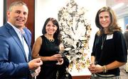 """CBJ Seen: Artists and friends of McColl Center for Visual Art gathered last month at Babson Capital for an exhibit by former artists-in-residence. From left: Babson CEO Tom Finke, exhibition manager Claudia Gonzalez-Griffin and artist Jennifer Parham Gilomen. Want to see your events featured? Send photos and captions in an email to aangel@bizjournals.com, with """"CBJ Seen"""" in the subject line."""