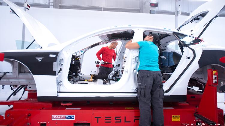Tesla will complete a scheduled retooling of its factory that will  shut it down for a few weeks.