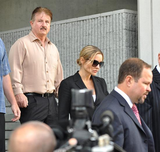 William Wendell acompanies daughter Kim Rothstein from the federal courthouse in Fort Lauderdale following her sentencing on Nov. 12.