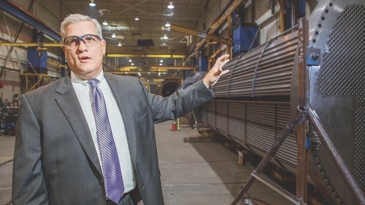 President and CEO James Lines showcasing Graham Corp. parts. (file photo)