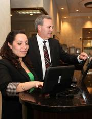 Stephany Usubillaga, service supervisor at Bank of Tampa's St. Petersburg branch, and Craig West, VP office manager, at the tech bar, where clients can practice online banking and mobile apps.