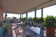 The condo includes an expansive covered terrace.