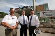Rick Wilton, construction superintendent for Ed  Taylor Construction, T. Gene Evans, senior VP retail administrator at USAmeriBank and Joseph Riggs,  senior VP retail manager, at USAmeriBank's branch under construction at 405 N. West Shore Blvd. in Tampa.