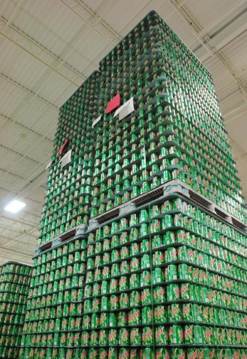 Pallets of empty cans are stacked at Ball Metal Container Group in Golden, Colo., a unit of Ball Corp.
