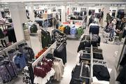 Racks of clothing were prepared Thursday morning for the store's grand opening.