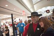 """Employees such as """"Cowboy"""" posed for pictures with customers."""