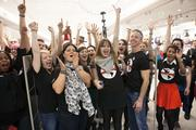 Employees celebrated the ribbon cutting.