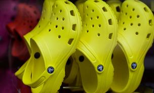 Crocs Inc. is reportedly looking into taking the company private amid dwindling sales and profits in recent years.