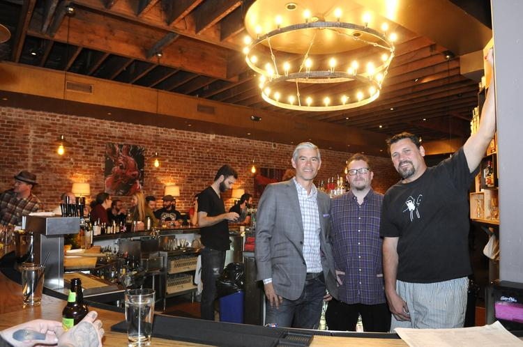 Red Rabbit Kitchen and Bar owner Sonny Mayugba, left, along with his partners Matt Nurge and John Bays, has dealt with the good and the bad sides of online review sites like Yelp.