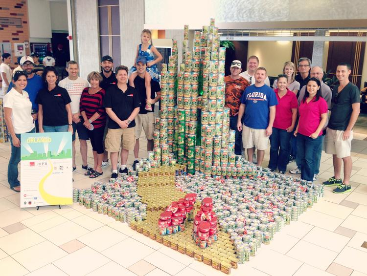 The Huntonbrady Architects team with their CANstruction entry. The event was held at Fashion Square Mall. All the canned goods used to build it were donated to Second Harvest Food Bank.
