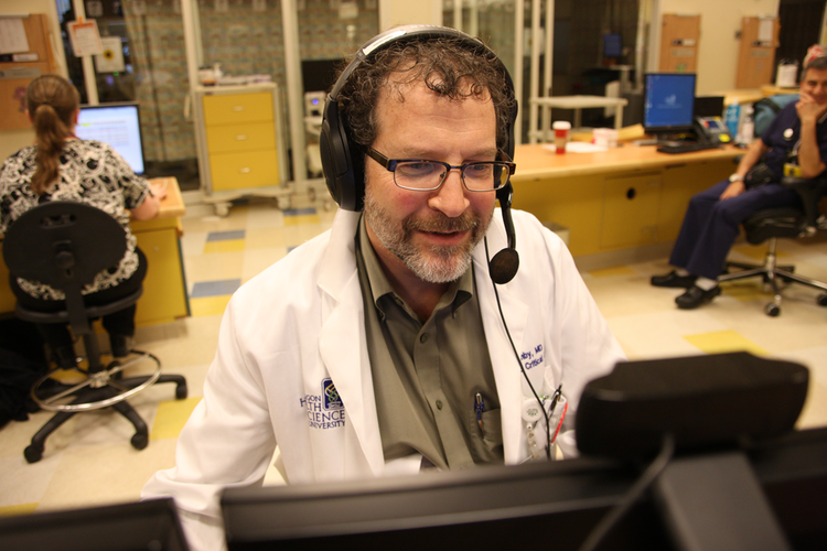 Dr. Miles Ellenby of OHSU consults with a patient remotely using telemedicine.