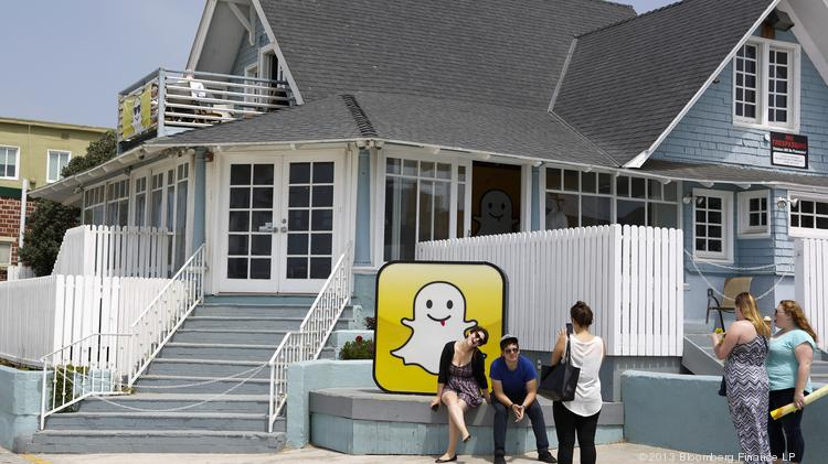 People take pictures in front of the Snapchat Inc. headquarters on the strand at Venice Beach in Los Angeles, California.