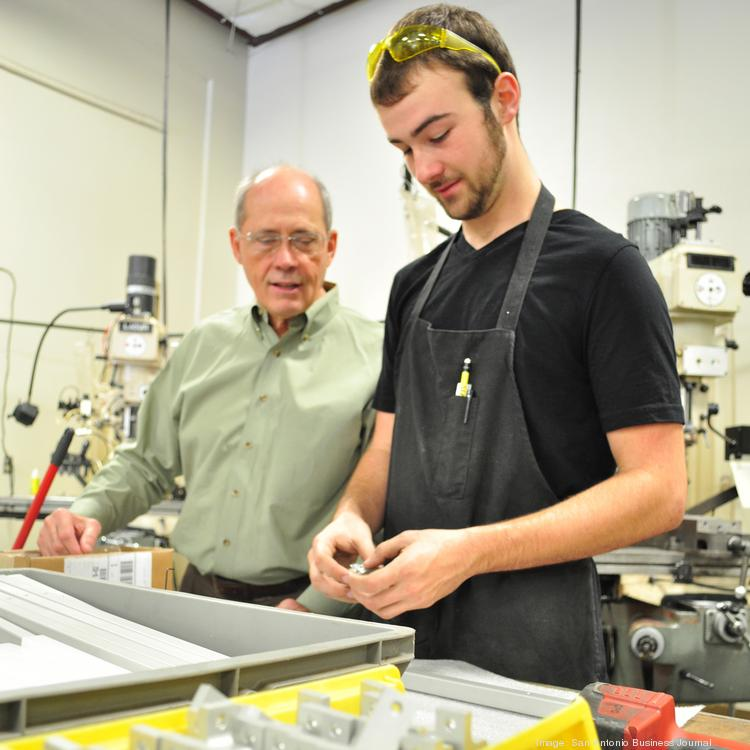 ITM Co. CEO Klaus Weiswurm (left) and Cale Chambers, apprentice machinist, discuss product specifications. Chambers interned with ITM during the summer of 2012 and was hired full-time after graduating from Canyon High School this year.