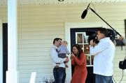 A news crew filmed a segment on flipping homes for ABC's Nightline at an open house at 1632 Logie Ave. Shown here is Rebecca Jarvis, chief business and economics correspondent for ABC News, speaking with potential buyer Brad Smith and his son Christian Smith. The videographer is Frank Nester.