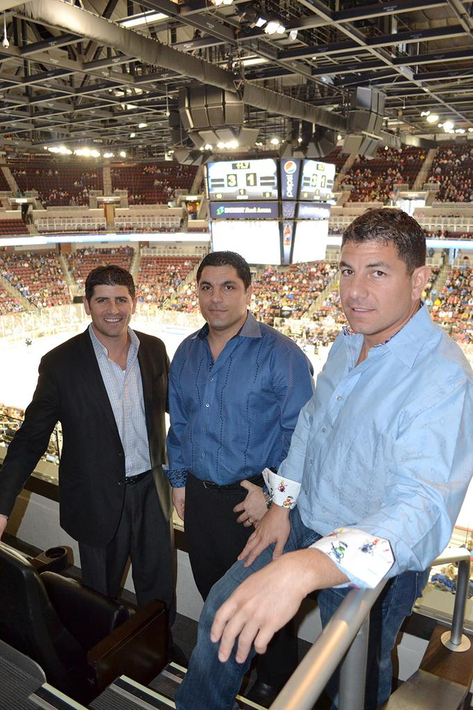 Wichita Thunder owners Rodney Steven, left, Johnny Steven, center, and Brandon Steven, right, attend most of the team's home games and some that are on the road.