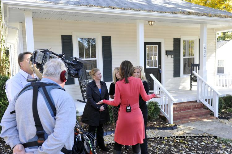 A news crew filmed a segment on flipping homes for ABC's Nightline at an open house at 1632 Logie Ave. Shown here is Rebecca Jarvis, chief business and economics correspondent for ABC News interviewing first-time flippers Lisa Kaouss, Alida Hunter and Armella DiOrio.