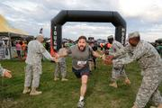 A Tough Mudder contestant gets some encouragement at the finish line.