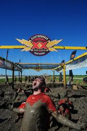 A Tough Mudder participant in Texas lets loose with some primal joy.