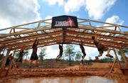 A Tough Mudder obstacle draws plenty of enthusiastic souls.