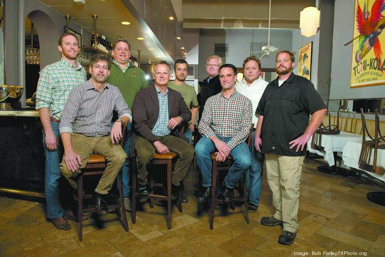Chris Hastings, front left, and Frank Stitt, center, at Highland's Bar and Grill with chefs who have worked for them and opened their own shops.