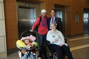 Cassidy Alexis Cole, 2, is Sebastian's sister. She poses with her family and Mike Stephens, West Market leader and president of Mercy Health.