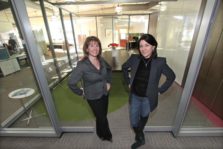 From left, Contract Associates' Kate Potter and Maria Griego-Raby at an open conference room at their offices