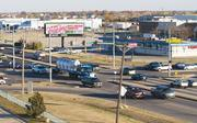 Vehicles pass through the Kellogg and Webb Road intersection Tuesday night during rush hour. The intersection is the busiest in Wichita.
