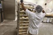 Samir works at Whole Foods Bakery in Aurora to make money but has hopes to become a doctor.