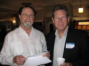 Al Fox, president of the Alliance for Responsible Cuba Policy Foundation, and Don Barco, right, owner of King Corona Cigars, at the conference.