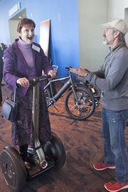 Johnny Graves of Segway of Cincinnati talks with Sue Shearer of ProSource at the expo.
