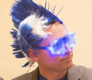 Tim Rettig of INTRUST IT wore a spiked-hair wig to the event. INTRUST IT was a  finalist in the micro category.