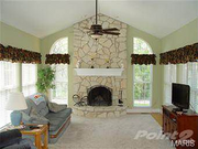 313 Jungermann Road: This custom-built home features four masonry gas fireplaces.