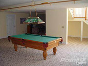 313 Jungermann Road: A basement room was used for games.