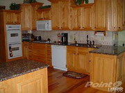 313 Jungermann Road: The kitchen has hardwood flooring, hickory cabinets, granite countertops and double gas ovens.