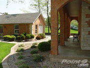 313 Jungermann Road: The property features a six-car garage (rear in photo).