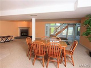120 Gailwood Drive: The finished basement has a space that can be used as another bedroom. A third fireplace, recreation room and full bar are also located in the basement.