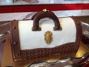 A Buche de Noel, a tiramisu-flavored pastry concoction in the form of a woman's hand bag.