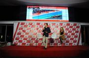 Enrique Arribas, director of advertising and sponsorship for Santander Group, speaks to reporters at Thursday's press conference. Also on stage is Katherine Klingler, U.S. chief marketing officer for Santander.