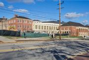 The Armstrong Student Center is being built on Spring Street in the heart of Miami University's campus. It combines previously freestanding buildings with new construction.
